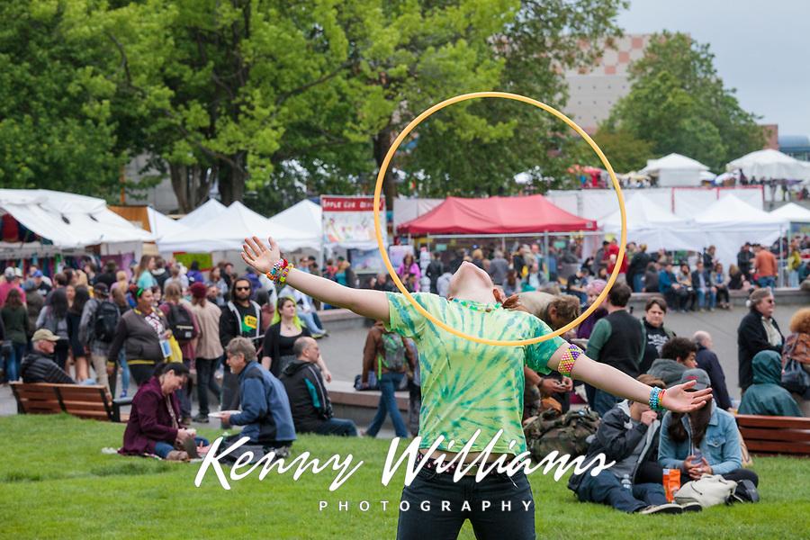 Girl performing with hula hoop, Northwest Folklife Festival 2016, Seattle Center, Washington, USA.