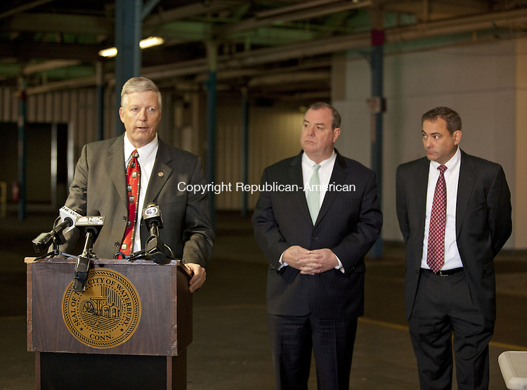 WATERBURY, CT-15 NOVEMBER 2013-111513BF03- Consultant Matt Cook discusses the plan for a medical marijuana facility as Waterbury Mayor Neil M. O'Leary and Tom Macre Executive Director of C-Three look on during a press conference at the site Friday morning. The proposed 70,000 square-foot site on East Aurora Street in Waterbury  will house two separate companies at the site to grow and distribute medical marijuana. Bob Falcetti Republican-American
