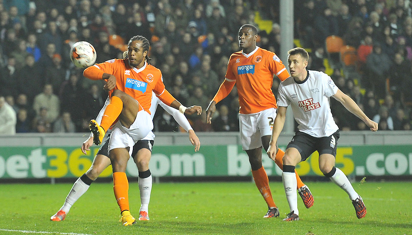 Blackpool's Nathan Delfouneso's shot goes over the bar<br /> <br /> Photographer Dave Howarth/CameraSport<br /> <br /> Football - The Football League Sky Bet Championship - Blackpool v Derby County - Tuesday 21st October 2014 - Bloomfield Road - Blackpool<br /> <br /> &copy; CameraSport - 43 Linden Ave. Countesthorpe. Leicester. England. LE8 5PG - Tel: +44 (0) 116 277 4147 - admin@camerasport.com - www.camerasport.com