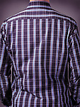 Closeup of a back of a man in stylish blue tartan shirt. Rear view.