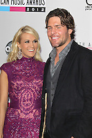 LOS ANGELES, CA - NOVEMBER 18: Mike Fisher and Carrie Underwood at the 40th American Music Awards held at Nokia Theatre L.A. Live on November 18, 2012 in Los Angeles, California. Credit: mpi20/MediaPunch Inc. NortePhoto