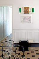 A detail of the living room showing one of the metal mesh chairs which were found in Spain