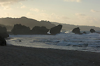 The rocks at Bathsheba as the sun sinks below the hills to the west.