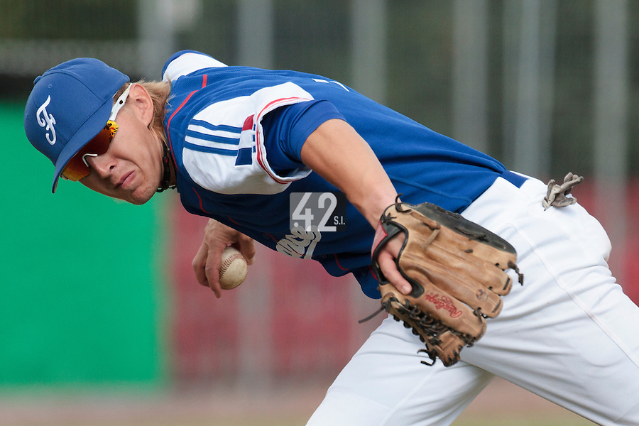30 july 2010: Luc Piquet of France throws the ball to first base during Sweden 3-2 win over France, in day 6 of the 2010 European Championship Seniors, at TV Cannstatt ballpark, in Stuttgart, Germany.