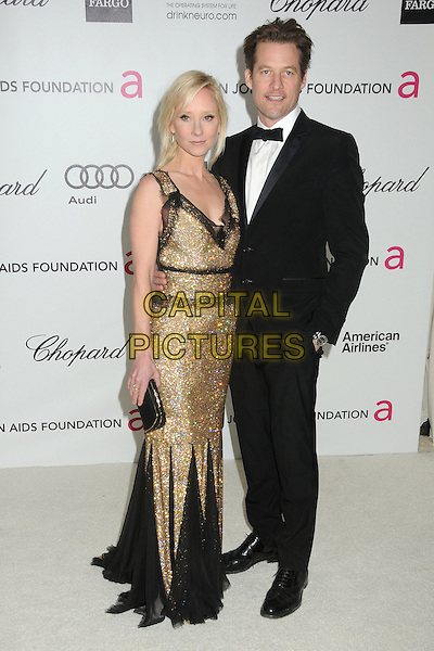 Anne Heche, James Tupper.20th Annual Elton John Academy Awards Viewing Party held at West Hollywood Park, West Hollywood, California, USA..February 26th, 2012.full length black gold dress lace beads beaded clutch bag tuxedo couple oscars.CAP/ADM/BP.©Byron Purvis/AdMedia/Capital Pictures. Oscars