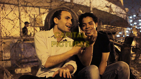 Khalid Abdalla &amp; Ahmed Hassan<br /> in The Square (2013) <br /> *Filmstill - Editorial Use Only*<br /> CAP/NFS<br /> Image supplied by Capital Pictures