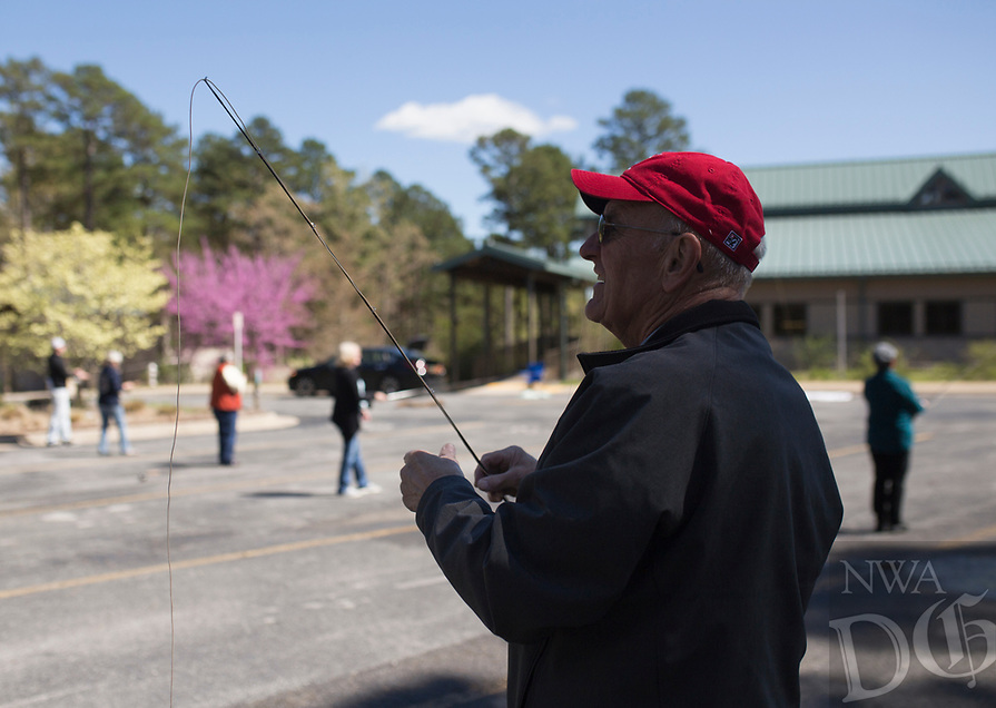 NWA Democrat-Gazette/CHARLIE KAIJO Loyal Steube of Rogers reels his rod during a fly fishing class, Sunday, April 14, 2019 at Hobbs State Park in Rogers.<br /> <br /> Instructor Sallyann Brown, past recipient of the &ldquo;Woman of the Year&rdquo; and the &ldquo;Federation of Fly Fishers Educator of the Year&rdquo; awards from the Federation of Fly Fishers, Inc. taught a four hour fly fishing class.<br /> <br /> Participants learned four basic casts, the six basic types of flies (lures), how to cast and &ldquo;play&rdquo; the flies in the water, how to read water, how to wade, how to purchase and assemble equipment, how to store equipment and how to tie the four basic knots used by fly fishers.