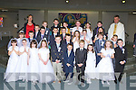 The pupils from Lissivigeen NS who received their First Holy Communion in the Church of the Ressurection on Saturday with Fr Kieran O'Brien and teacher Martina Lynch