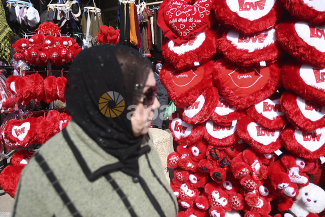Palestinian man displays hearts in the shop to commemorate Valentine's Day adorned with sayings about love, in West Bank City of Nablus, on February 13, 2012. Valentine's Day is celebrated each year on 14 February. Photo by Wagdi Eshtayah