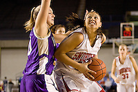 Snohomish guard Karley Lampman drives toward the basket past Lake Stevens guard Mary Ochiltnee after a rebound in the first quarter at the Tacoma Dome, Friday Feb 29. Chris Hunt for the News Tribune