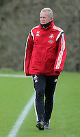 SWANSEA, WALES - JANUARY 28: Interim manager Alan Curtis watches a game played by some of the players during the Swansea City Training Session on January 28, 2016 in Swansea, Wales.