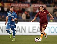 Calcio, Serie A: Roma, stadio Olimpico, 1 aprile, 2017.<br /> Roma's Francesco Totti (r) in action with Empoli's Marcel Buchel (l) during the Italian Serie A football match between Roma and Empoli at Olimpico stadium, April 1, 2017<br /> UPDATE IMAGES PRESS/Isabella Bonotto