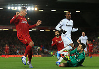 24th February 2020; Anfield, Liverpool, Merseyside, England; English Premier League Football, Liverpool versus West Ham United; West Ham United goalkeeper Lukasz Fabianski saves at the feet of Roberto Firmino of Liverpool