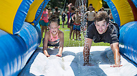 NWA Democrat-Gazette/BEN GOFF @NWABENGOFF<br /> Taylor Fry, 11, of Rogers and Kyle Bowman, camp counselor, dive onto a water slide Tuesday, Aug. 6, 2019, during the Summer Day Camp at the Rogers Activity Center. This week's camp is the center's final session of the summer season.