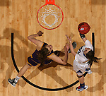 SIOUX FALLS, SD - MARCH 10: Amanda Hyde #11 from IPFW takes the ball to the basket against  Ashley Luke #5 from Western Illinois in the second half of their quarterfinal game Sunday afternoon at the 2013 Summit League Championships in Sioux Falls, SD.  (Photo by Dave Eggen/Inertia)