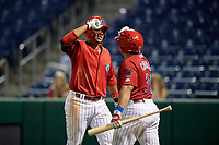 Clearwater Threshers first baseman Darick Hall (21) is congratulated by Edgar Cabral (30) after hitting a seventh inning home run during a game against the Jupiter Hammerheads on April 12, 2018 at Spectrum Field in Clearwater, Florida.  Jupiter defeated Clearwater 8-4.  (Mike Janes/Four Seam Images)