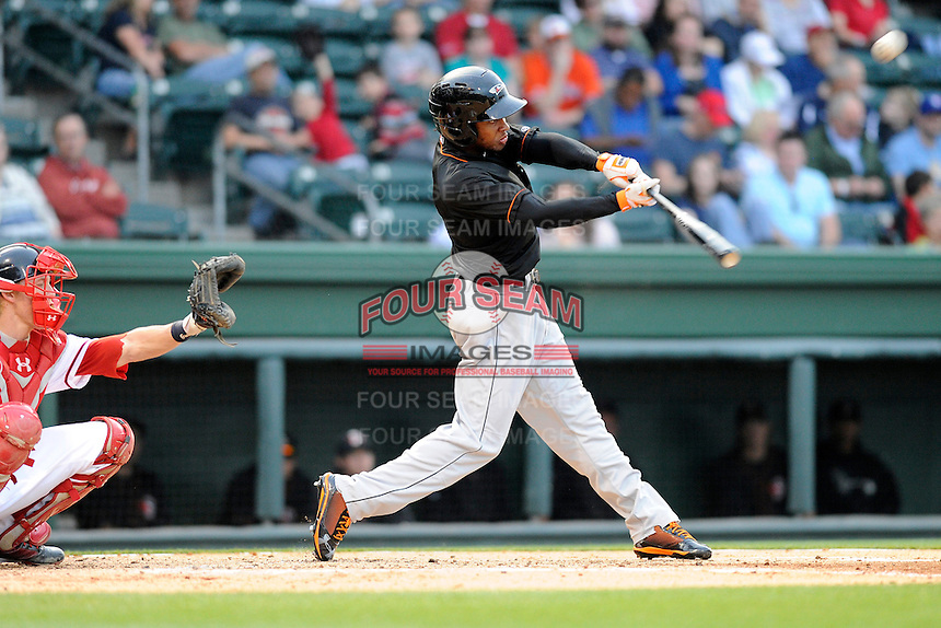 Outfielder Gregory Lorenzo (1) of the Delmarva Shorebirds bats in a game against the Greenville Drive on Friday, April 26, 2013, at Fluor Field at the West End in Greenville, South Carolina. Lorenzo is listed as the No. 29 prospect of the Baltimore Orioles, according to Baseball America. Delmarva won, 10-3. (Tom Priddy/Four Seam Images)