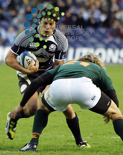 Scotland v South Africa, Murrayfield Stadium, Edinburgh - 15/11/2008.Bank of Scotland Corporate Test..South Africa's Frans Steyn stops Scotland's Hugo Southwell.  The full time score was Scotland 10 - South Africa 14.  Picture by John Cockburn/ Universal News & Sport (Scotland)....All pictures must be credited to www.universalnewsandsport.com.(0ffice) 0844 884 51 22. ........... .