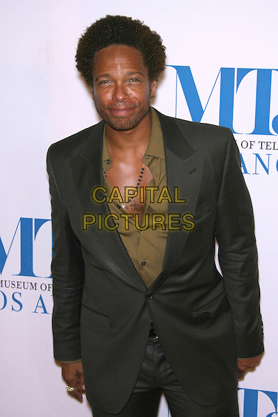 GARY DOURDAN.The Museum of Television & Radio To Honor Leslie Moonves and Jerry Bruckheimer At its Annual Los Angeles Gala held at Regent Beverly Wilshire Hotel, Beverly Hills, California, USA..October 30th, 2006.Ref: ADM/ZL.half length black suit jacket unbuttoned.www.capitalpictures.com.sales@capitalpictures.com.©Zach Lipp/AdMedia/Capital Pictures.