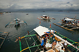 PHILIPPINES, Palawan, Puerto Princesa, Handline fishermen in the City Port Area load boats with ice and prepare for a week long trip