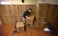 NWA Democrat-Gazette/BEN GOFF @NWABENGOFF<br /> Robby Sponseller of Bentonville and Ginny Harper of Pea Ridge stack and inventory boxes arriving from First Baptist Church in Centerton on Thursday Nov. 19, 2015 while volunteering at the Operation Christmas Child Northwest Arkansas Collection Center at Calvary Chapel in the Ozarks in Rogers. Operation Christmas Child shoe boxes collected from relay centers at area churches are crated and brought to the collection center where they will be shipped to Denver, Colo. for processing and distribution.
