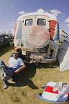 Relaxing Next to His Painted Bus