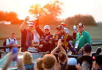 Jul. 1, 2012; Joliet, IL, USA: NHRA drivers (from left) pro stock motorcycle rider Andrew Hines , pro stock driver Erica Enders and funny car driver Jeff Arend celebrate after winning the Route 66 Nationals at Route 66 Raceway. Mandatory Credit: Mark J. Rebilas-