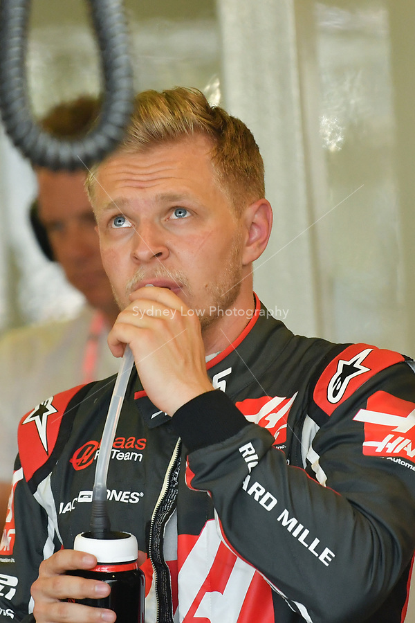 March 23, 2018: Kevin Magnussen (DEN) #20 from the Haas F1 Team watches the monitor in his garage during practice session two at the 2018 Australian Formula One Grand Prix at Albert Park, Melbourne, Australia. Photo Sydney Low
