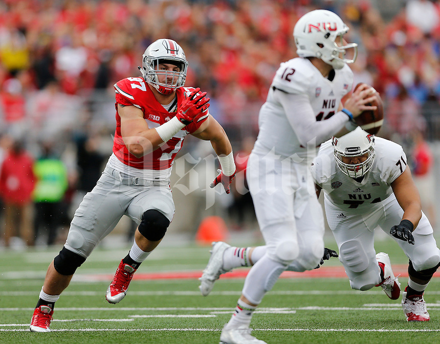 Ohio State Buckeyes defensive lineman Joey Bosa (97) pressures Northern Illinois Huskies quarterback Drew Hare (12) during the first quarter of the NCAA football game at Ohio Stadium in Columbus on Sept. 19, 2015. (Adam Cairns / The Columbus Dispatch)