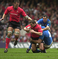 27/03/2004  -  RBS Six Nations Championship 2004 Wales v Italy.Iestyn Harris is tackled by Santiago Dellape [No.4] and Christian Stoica.   [Mandatory Credit, Peter Spurier/ Intersport Images].