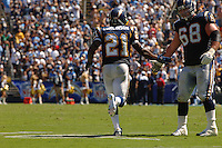 Sept. 17, 2006; San Diego, CA, USA; San Diego Chargers running back (21) LaDainian Tomlinson is congratulated by guard (68) Kris Dielman after scoring a touchdown against the Tennessee Titans at Qualcomm Stadium in San Diego, CA. Mandatory Credit: Mark J. Rebilas