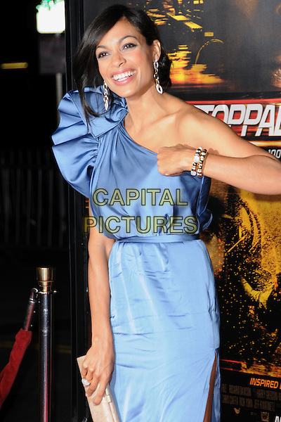 "ROSARIO DAWSON.attends the Twentieth Century Fox's L.A. Premiere of ""Unstoppable"" held at Regency Village Theater in Westwood, California, USA, October 26th 2010..half length dress blue one shoulder silk satin clutch bag beige hand smiling bracelet nude .CAP/RKE/DVS.©DVS/RockinExposures/Capital Pictures."