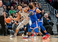 WASHINGTON, DC - DECEMBER 28: Jamorko Pickett #1 of Georgetown sends the ball past Jamir Harris #4 of American. during a game between American University and Georgetown University at Capital One Arena on December 28, 2019 in Washington, DC.