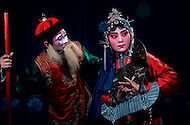 April 15th, 1989, Poyang, Jiangxi Province, China. Traveling opera troupe actors performing. Roles in Chinese opera are highly codified. All performers take care of their own make up, clothes and props.