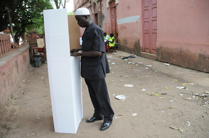 Bissau/June 28 - A voter in Guinea-Bissau casts his ballot in the country's presidential election on June 28. The West African nation is one of the poorest on the continent--it is ranked 171 out of 179 nations in the U.N. Development Programme's Human Development Index, and life expectancy at birth is less than 46 years. The election comes four months after the leader João Bernardo Vieira was killed by mutinous troops.