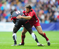 Kenya's Andrew Noel Omondi Amonde is tackled by Wales's Adam Thomas<br /> <br /> Kenya Vs Wales - men's placing 5-8 match<br /> <br /> Photographer Chris Vaughan/CameraSport<br /> <br /> 20th Commonwealth Games - Day 4 - Sunday 27th July 2014 - Rugby Sevens - Ibrox Stadium - Glasgow - UK<br /> <br /> © CameraSport - 43 Linden Ave. Countesthorpe. Leicester. England. LE8 5PG - Tel: +44 (0) 116 277 4147 - admin@camerasport.com - www.camerasport.com