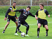 Costa Barbarouses holds off Aaron Scott (right) and Manny Muscat during the Wellington Phoenix A-League football training session Training Session at Newtown Park, Wellington, New Zealand on Monday, 4 May 2009. Photo: Dave Lintott / lintottphoto.co.nz