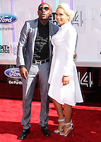 LOS ANGELES, CA, USA - JUNE 29: Boxer Floyd Mayweather, Jr. and Doralie Medina arrive at the 2014 BET Awards held at Nokia Theatre L.A. Live on June 29, 2014 in Los Angeles, California, United States. (Photo by Xavier Collin/Celebrity Monitor)