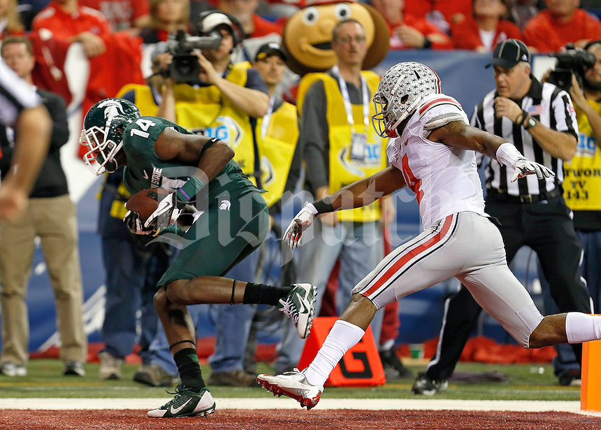 Michigan State Spartans wide receiver Tony Lippett (14) brings in a touchdown catch past Ohio State Buckeyes safety C.J. Barnett (4) during the first half of the Big Ten Championship football game at Lucas Oil Stadium in Indianapolis on Friday, December 7, 2013. (Columbus Dispatch photo by Jonathan Quilter)
