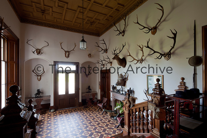 The outer hall is a classic example of Victorian baronial display, featuring numerous hunting trophies and weaponry