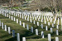 Rows of white grave markers fade into the distance in Arlington National Cemetery, Arlington, Virginia