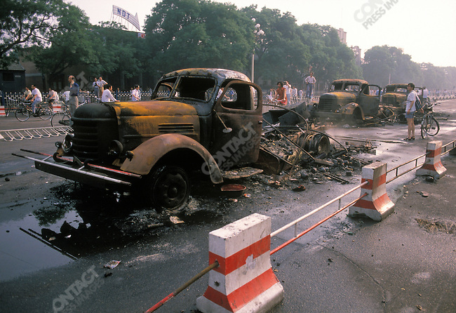 Burned trucks, aftermath of military crackdown on pro-democracy protests, Changan Avenue, TiananmenSquare, Beijing, China, June 1989