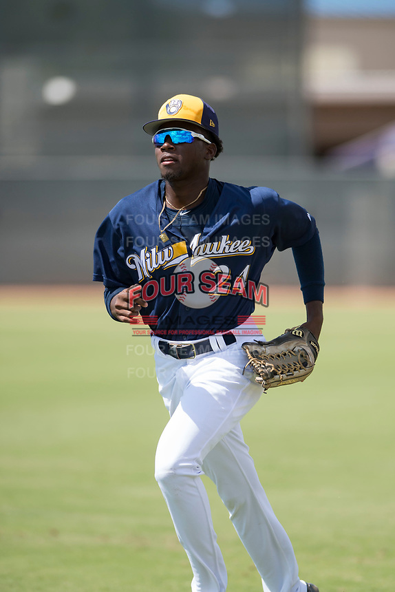 Milwaukee Brewers right fielder Larry Ernesto (24) jogs off the field between innings of an Instructional League game against the Los Angeles Dodgers at Maryvale Baseball Park on September 24, 2018 in Phoenix, Arizona. (Zachary Lucy/Four Seam Images)