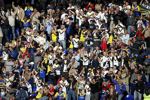 10 April 2005: Warrington supporters celebrate during the Engage Super League match between Warrington Wolves and Bradford Bulls. Warrington won the game 35-32 played at the Halliwell Jones Stadium, Warrington. Photo: Neil Tingle/Action Plus...050410 fan crowd superleague