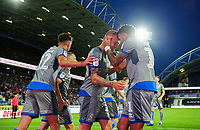 Lincoln City's Harry Anderson, centre, celebrates scoring the opening goal with team-mates Ellis Chapman, left, and Bruno Andrade<br /> <br /> Photographer Chris Vaughan/CameraSport<br /> <br /> The Carabao Cup First Round - Huddersfield Town v Lincoln City - Tuesday 13th August 2019 - John Smith's Stadium - Huddersfield<br />  <br /> World Copyright © 2019 CameraSport. All rights reserved. 43 Linden Ave. Countesthorpe. Leicester. England. LE8 5PG - Tel: +44 (0) 116 277 4147 - admin@camerasport.com - www.camerasport.com