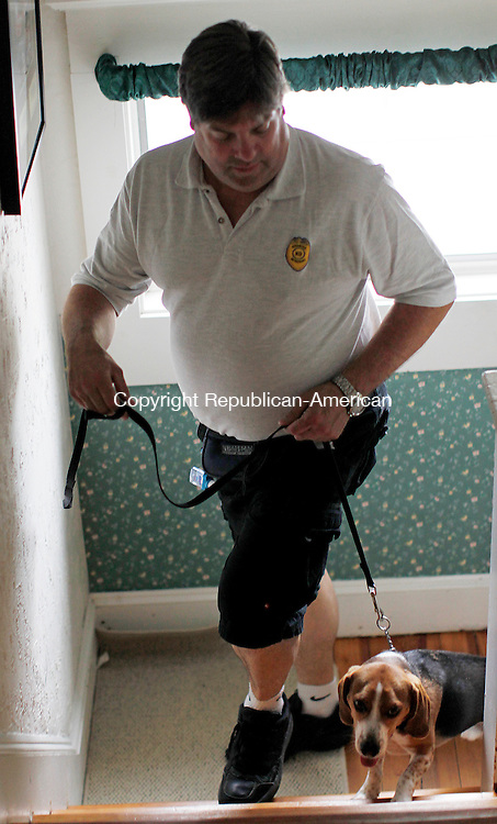 Milford, CT- 30, July 2010-073010CM03 Carl Massicott, and Radar, his four year old Beagle, begin their training exercise.  Massicott is the owner and founder of the first bedbug K9 scent detection company in the United States.  --Christopher Massa Republican-American