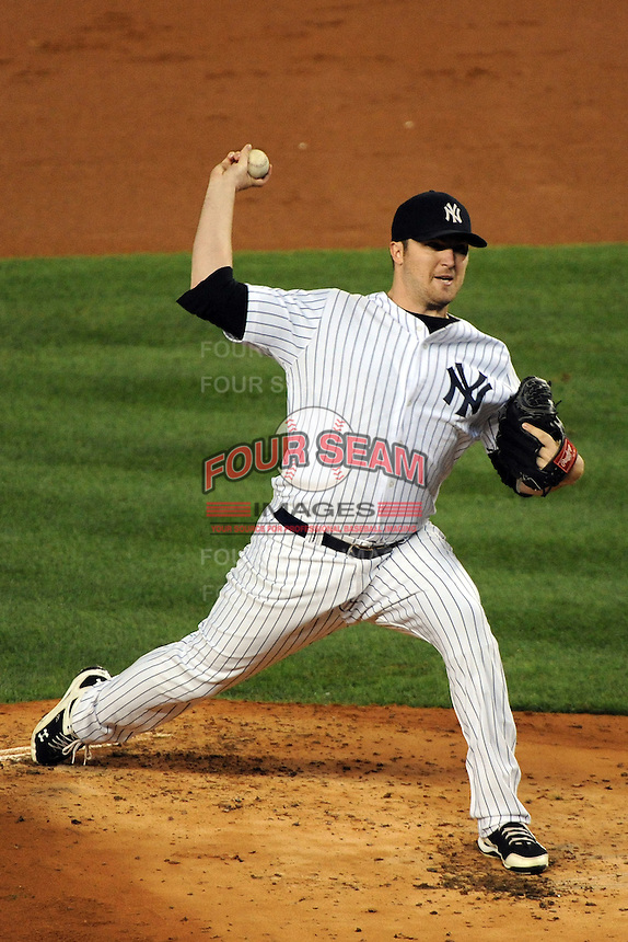 New York Yankees pitcher Phil Hughes #65 during ALDS game #5 against the Detroit Tigers at Yankee Stadium on October 06, 2011 in Bronx, NY.  Detroit defeated New York 3-2 to take the series 3 games to 2 games.  Tomasso DeRosa/Four Seam Images