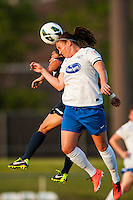Boston Breakers defender Cat Whitehill (4) goes up for a header with Sky Blue FC forward Monica Ocampo (8). Sky Blue FC defeated the Boston Breakers 5-1 during a National Women's Soccer League (NWSL) match at Yurcak Field in Piscataway, NJ, on June 1, 2013.