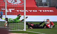15th July 2020; Ashton Gate Stadium, Bristol, England; English Football League Championship Football, Bristol City versus Stoke City; Daniel Bentley of Bristol City is unable to save the shot on goal from Danny Batth of Stoke City as he heads home a goal under pressure from Filip Benkovic of Bristol City in 62nd minute for 1-1