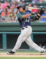 Catcher Roberto Pena (10) of the Lexington Legends, Class A affiliate of the Houston Astros, in a game against the Greenville Drive on August 5, 2011, at Fluor Field at the West End in Greenville, South Carolina. (Tom Priddy/Four Seam Images)